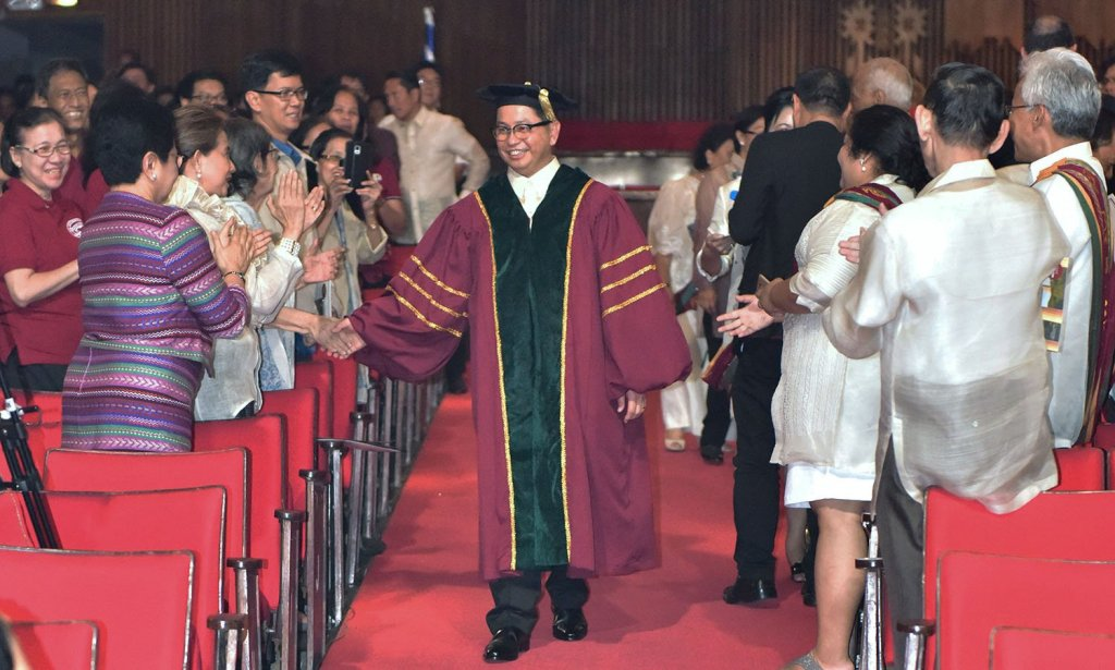 UP President Concepción enters the University Theater in the processional. (Photo by Bong Arboleda, UP MPRO)