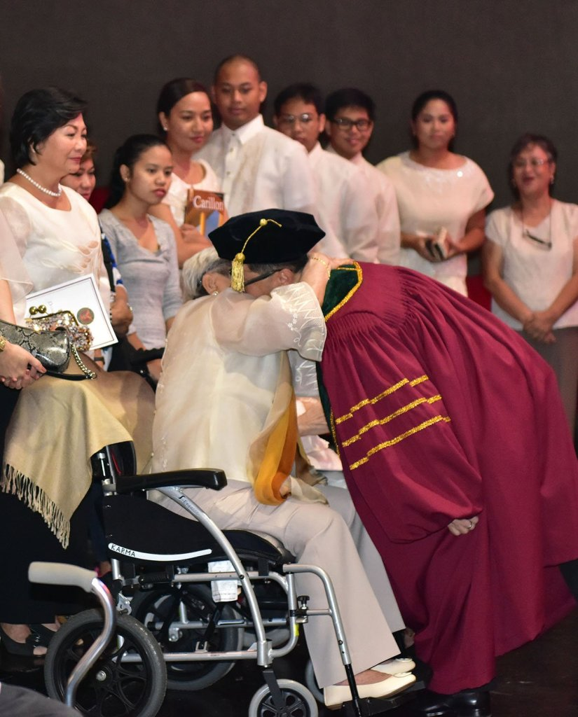 The UP president gets a hug from his mother, Mrs. Natalia Lardizabal Concepción. (Photo by Bong Arboleda, UP MPRO)