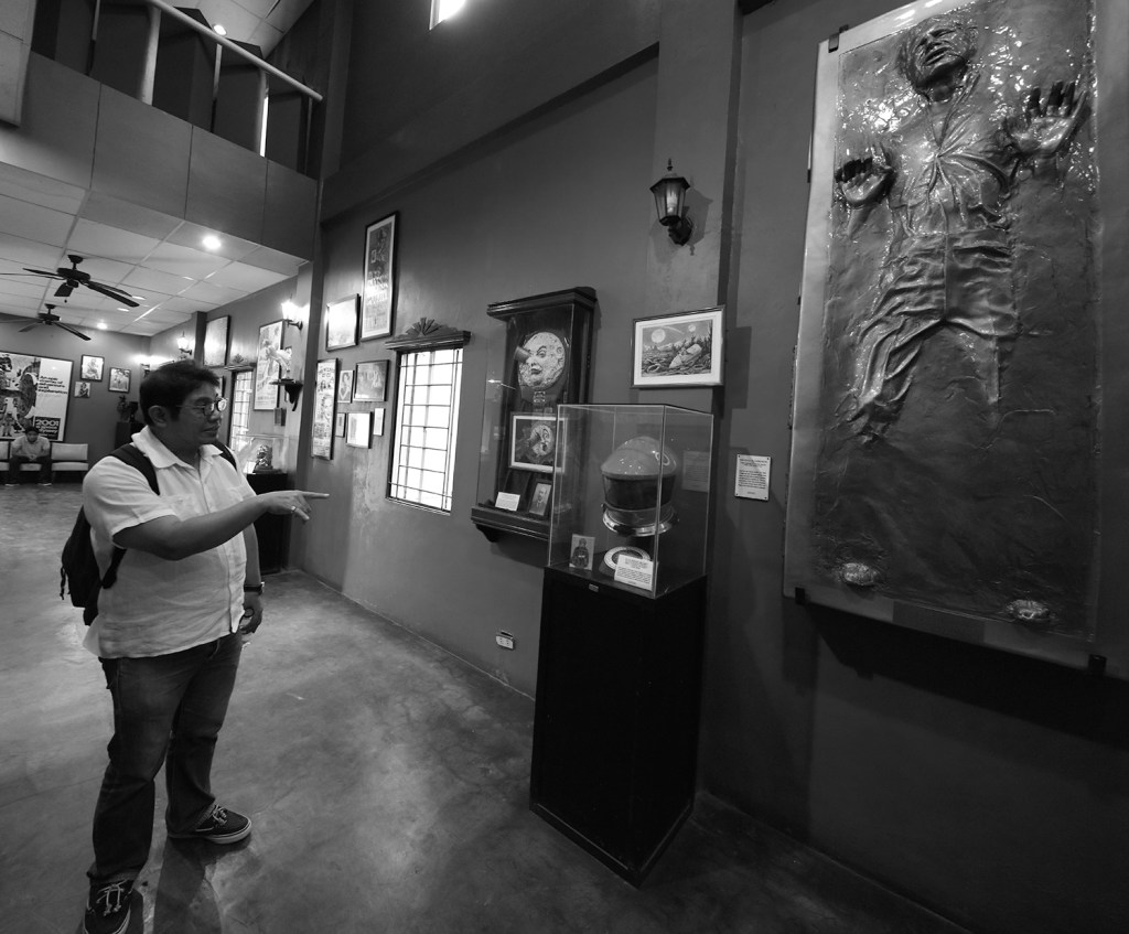 Prof. Martin Genodepa talking about the pieces in the film museum (Photo by Misael Bacani, UP MPRO)