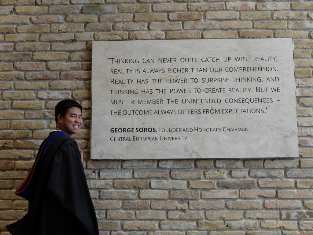 Prof. Arguelles poses with a marker in Central European University