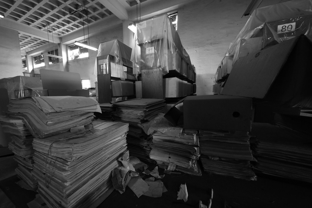One of the storage areas where records are protected from leaks by plastic covers. (Photo by Misael Bacani, UP MPRO)