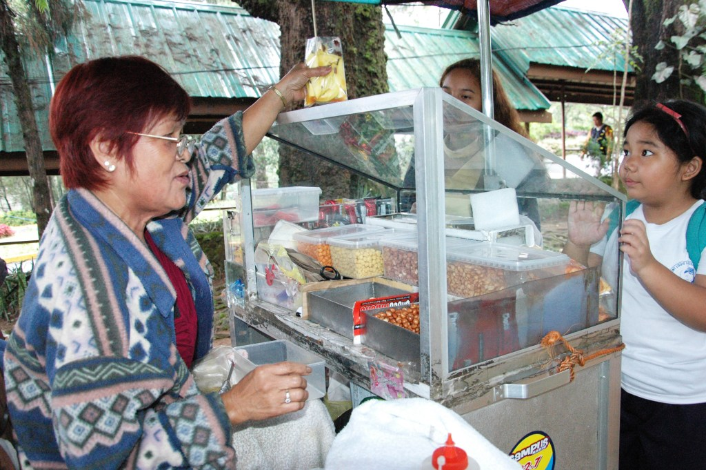 Nanay Mani chatting with a customer