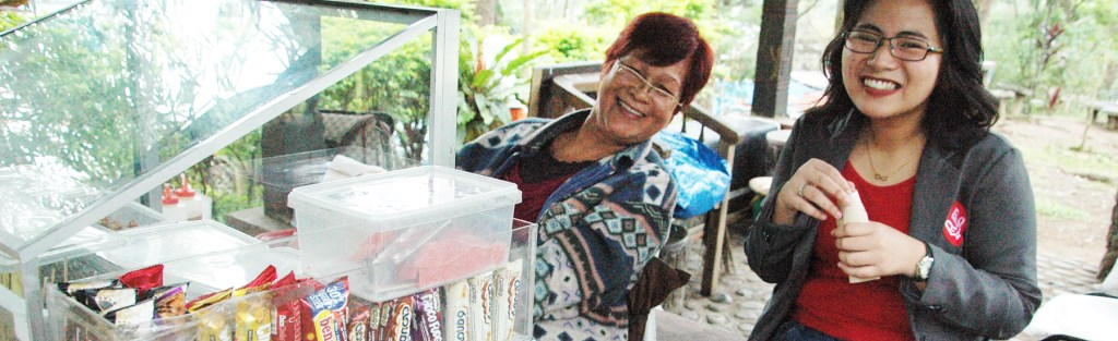 At the side of the main entrance of UP Baguio, in a kiosk underneath one of the many pine trees that mark UP's northernmost campus, is an institution perhaps as beloved among the members of the UP community as the Oblation itself: a peanut vendor famously known as Nanay Mani.