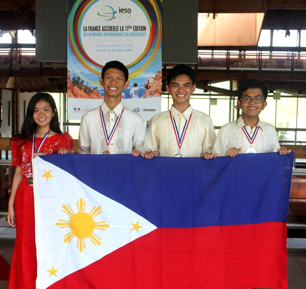 Adrian Bornilla (2nd from left) from the UPIS poses with the team and their medals