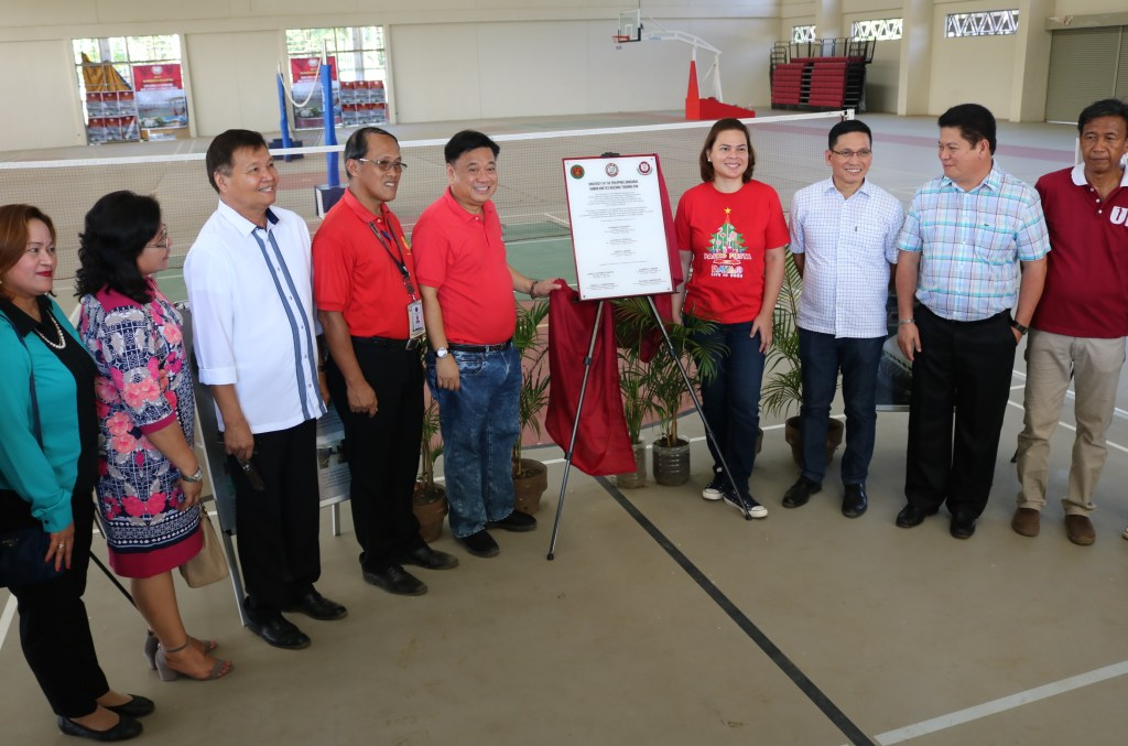 THE UP-MINDANAO TRAINING GYM building marker is unveiled by Davao City Mayor Sara Duterte-Carpio (beside marker) on December 5 in the company of former congressman Isidro Ungab and officials of the University of the Philippines-Mindanao, Dept. of Public Works and Highways, and Dept. of Education, to announce the first sports facility to be completed in the Davao City-UP Sports Complex in Mintal, Davao City
