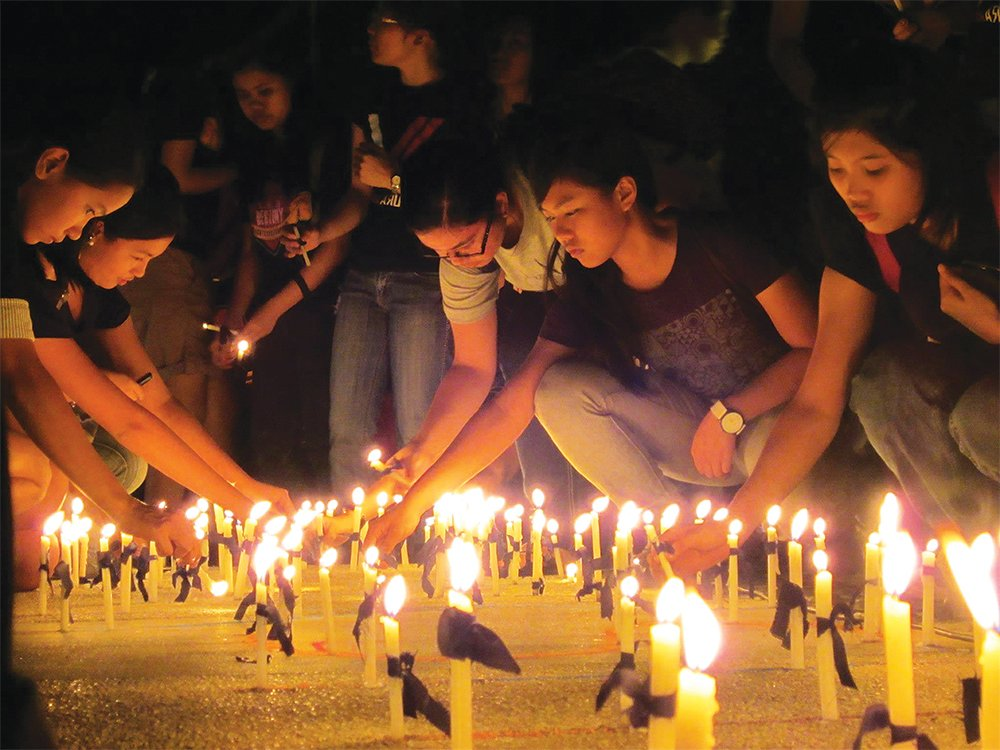 Students light candles to campaign for justice for Kristel Tejada (Photo from UP MPRO), 2013