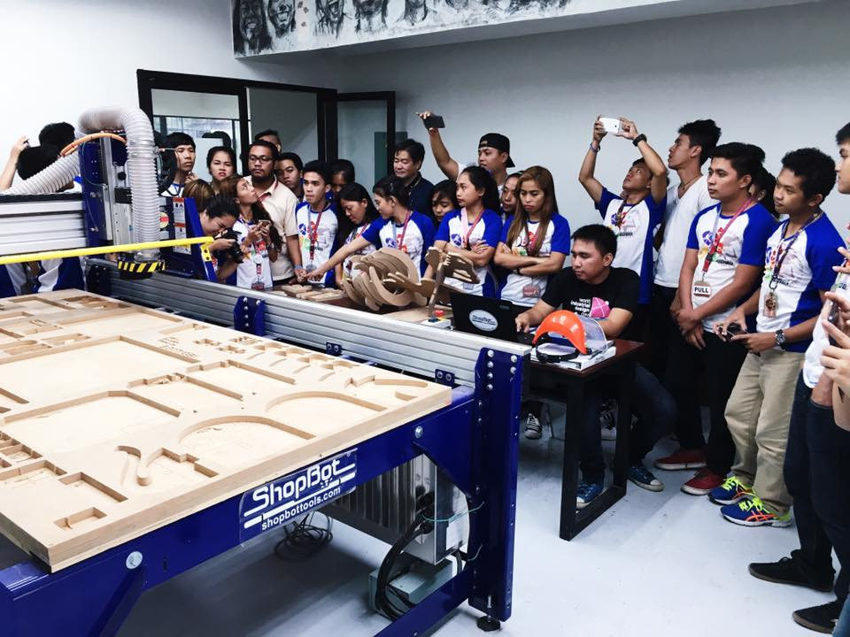 Students of the Professional Academy of the Philippines get a demonstration of CNC milling at the UP Cebu Fablab. (Photo courtesy of the Fablab UP Cebu Facebook)