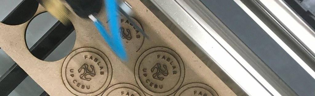 UP Cebu Fablab pins undergo laser-cutting.