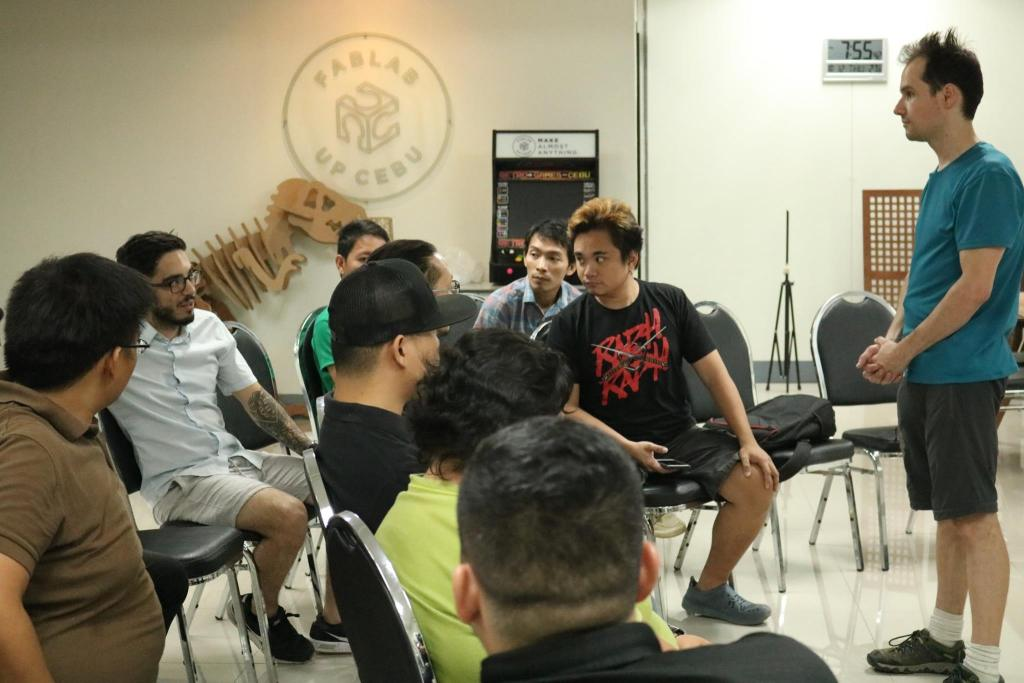 """A volunteer from Australia facilitates the first ever THINK. MAKE. BREAK. session at the UP Cebu Fablab. Participants from diverse backgrounds and expertise come together to learn from each other about becoming a """"maker"""". (Photo courtesy of the Fablab UP Cebu Facebook)"""