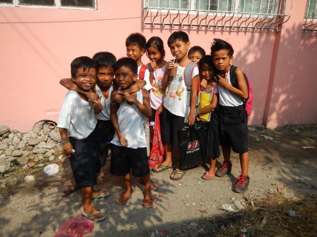 School children in the Barangays Balete, Tarlac City. Photo by Judgefloro, taken 2 July 2015 (Photo from Wikicommons, https://commons.wikimedia.org/wiki/File:01415ajfSchool_children_Philippines_Tarlacfvf_05.jpg)