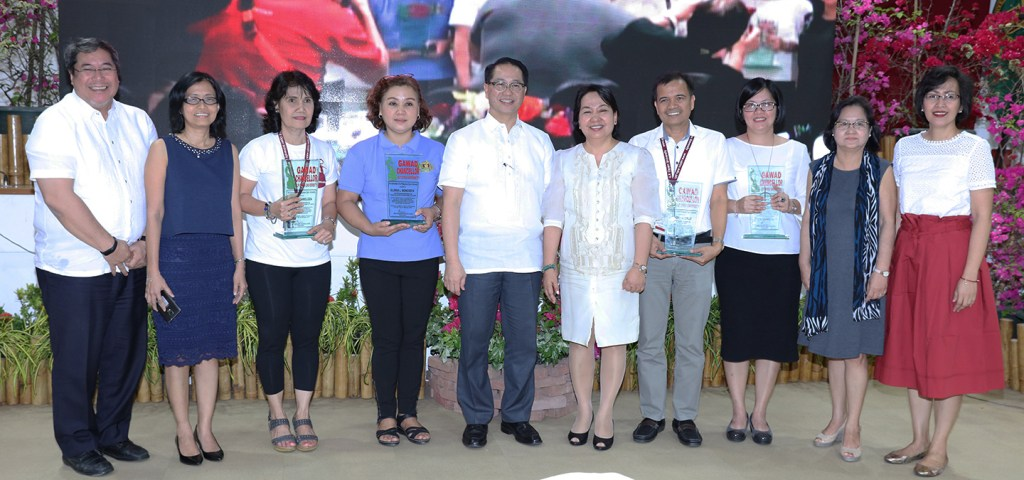 The Gawad Chancellor awardees with University officials: from left, UP Executive Vice President Teodoro Herbosa, UPOU Vice Chancellor for Finance and Administration Jean Saludadez, Gawad Chancellor for Outstanding Administrative Personnel (Second Level) awardee Pura Amoloza, Gawad Chancellor for Outstanding Administrative Personnel (First Level) awardee Gloria Boncodin, UP President Danilo Concepcion, UPOU Chancellor Melinda Bandalaria, Gawad Chancellor for Outstanding Research, Extension and Professional Staff (REPS) awardee Larry Cruz, Gawad Chancellor for Outstanding Faculty awardee Dr. Joane Serrano, Vice Chancellor for Academic Affairs Melinda Lumanta, and UP Faculty Regent Patricia Arinto (Photo by Misael Bacani, UP MPRO)
