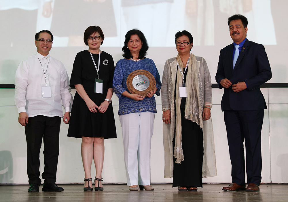 The speakers at the ASEANnale opening ceremony: from left, UP President Danilo Concepcion, ASEAN Foundation Chair Elaine Tan, Permanent Representative of the Philippines to ASEAN Elizabeth Buensuceso, ASEANnale 2018 Organizing Committee Chair Grace Javier Alfonso, and CHED OIC J. Prospero de Vera III (Photo by Misael Bacani, UP MPRO)