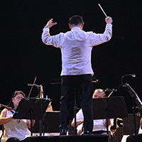 Maestro Herminigildo Ranera conducts the Philippine Philharmonic Orchestra in UP Diliman. (Photo by Jun Madrid, UP MPRO)