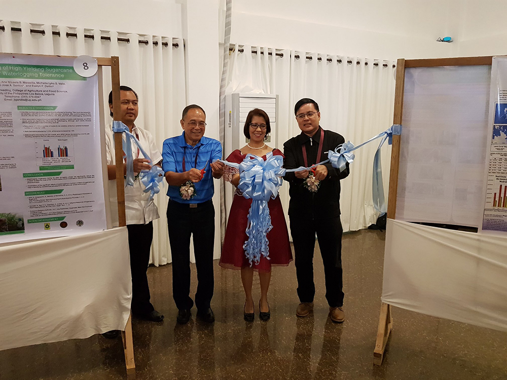(from left): Bureau of Agricultural Research's Joell Hizon Lales, UP REPSS President Fe dela Cueva, frmr. UP President Emil Javier and UP AVP for Public Affairs Jose Wendell Capili during the ribbon cutting ceremony at the poster section. (Photo by Bong Arboleda, UP MPRO)