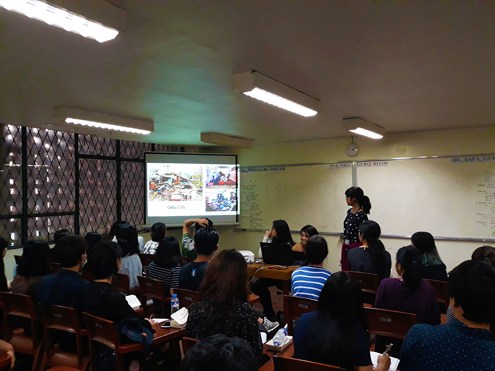 UPCIS students discussing the effect of typhoon Yolanda on the people of Eastern Visayas. (Photo courtesy of UPCIS)