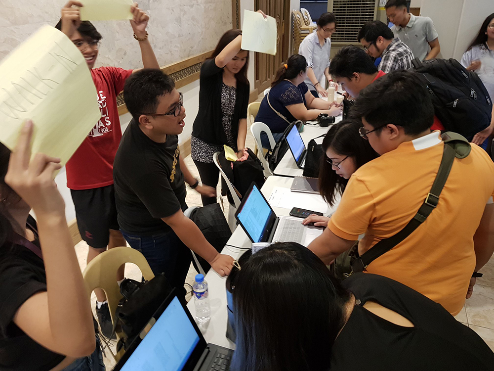 Students accommodate their peers at the registration table. (Photo by Jun Madrid, UP MPRO)