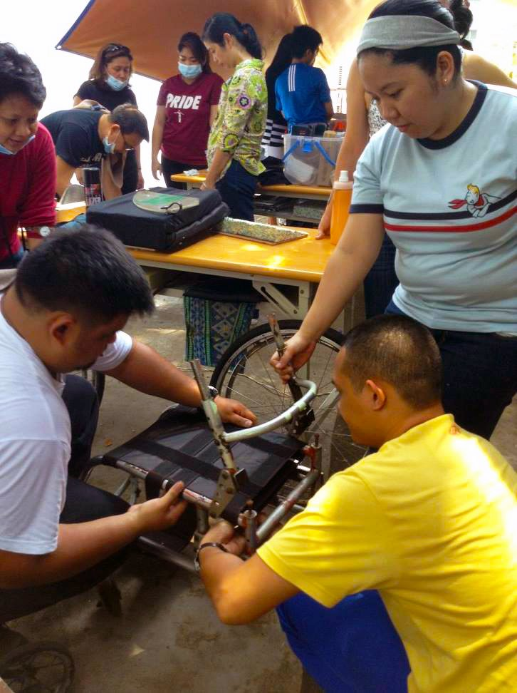 Program staff make adjustments on the wheelchair based on the user's needs and condition.