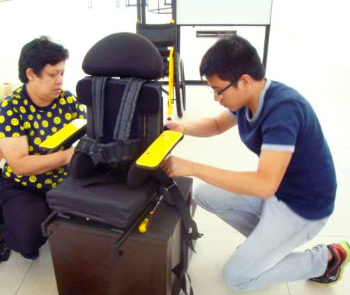 Attaching cushions and safety straps for a child-customized wheelchair seat. Photos from the Philippine Society of Wheelchair Professionals https://www.facebook.com/pg/WheelchairTrainingPSWP/photos/