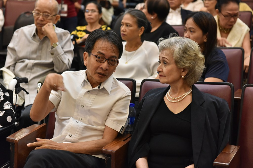 UP Diliman Chancellor Michael Tan talks to Mrs. Angara before mass begins. (Photo by Abraham Arboleda, UP MPRO)
