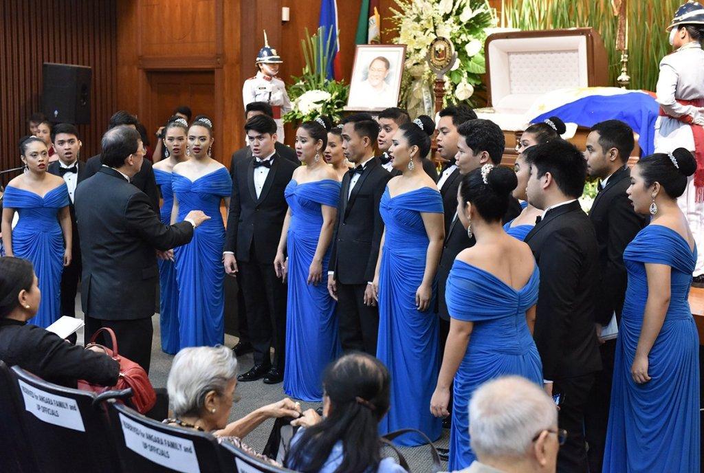 One of the many performances of the UP Singing Ambassadors throughout the necrological service. (Photo by Abraham Arboleda, UP MPRO)