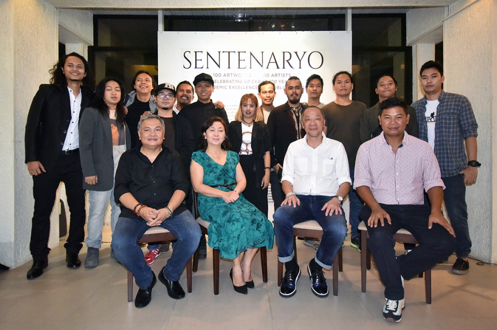 "Participating artists in the ""Sentenaryo"" art exhibit from a younger batch of the UP Cebu Fine Arts Program with UP Cebu Chancellor Liza Corro, College of Communication, Art, and Design Dean Juanito Karl Roque, and guests of honor Charlie Co and Manny Montelibano. (Photo by Bong Arboleda, UP MPRO)"