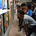 "Guests view the artworks featured in UP Cebu's ""Sentenaryo"" art exhibit at the Jose T. Joya Gallery. (Photo by Bong Arboleda, UP MPRO)"