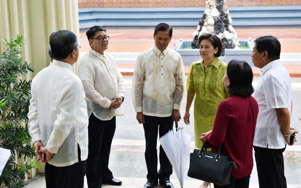 UP officials welcome VIPs to UP Cebu.