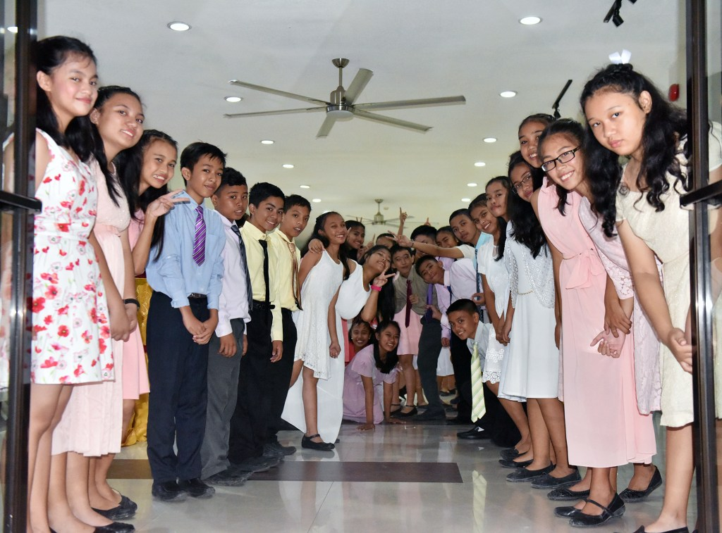 UP Cebu high school students welcome guests to the evening events at UP Cebu performing arts auditorium