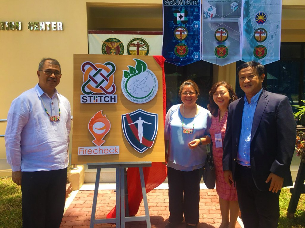 Department of Science and Technology Fortunato dela Peña and Undersecretary for Research and Development Rowena Cristina Guevara, UP Cebu Chancellor Liza Corro, and UP Regent Angelo Jimenez unveil the logos of new research and development centers and projects located in the new Technology Innovation Center of UP Cebu. (Photo by UP MPRO)