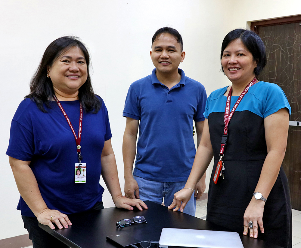 From left to right, some members of the UPOU Multimedia Center, the office behind UPOU Networks: University Researcher Luisa Gelisan, Information Systems Researcher Edison Sevilla, and Director Joane Serrano (Photo by Misael Bacani, UP MPRO)