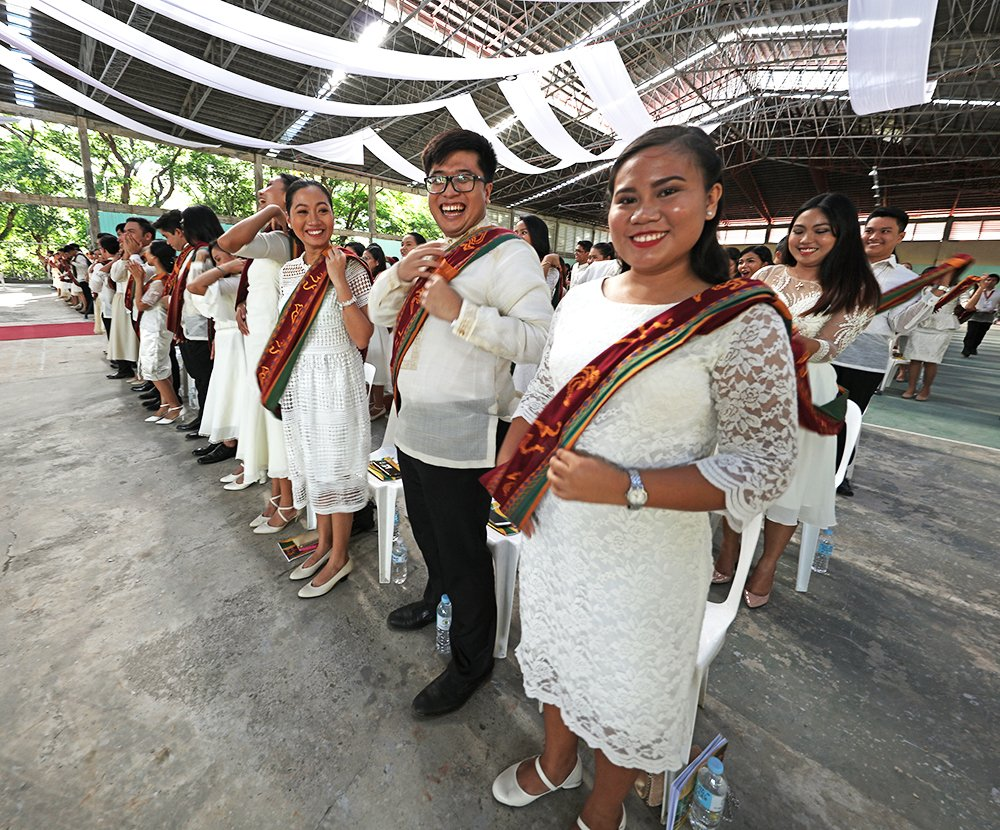 That moment of relief, happiness, and pride as they shift their UP Sablay from right to left, indicating that they have indeed graduated and earned their degrees. (Photo by Misael Bacani, UP MPRO)