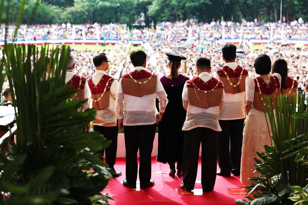 Sen. Loren Legarda, the UP Board of Regents, and UP Diliman Chancellor Michael Tan face the candidates for graduation while the citation is read. (Photo by Misael Bacani, UP MPRO)