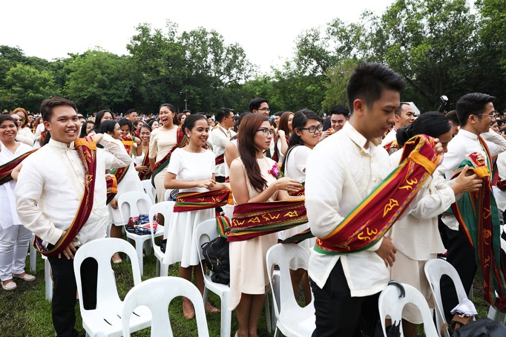 Candidates for graduation symbolically receive their degrees from President Danilo Concepcion by shifting the Sablay from the right shoulder to the left. (Photo by Misael Bacani, UP MPRO)