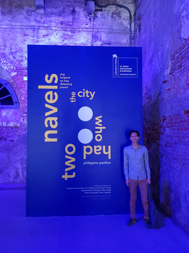 """Asst. Prof. Ryan Songcayauon of UP-Mindanao Dept. of Architecture at the Philippine Pavilion entrance in the """"16th Venice Architecture Biennale 2018"""" in Venice, Italy. (Photo courtesy of Rene Estremera, Public Relations Officer, UP Mindanao)"""