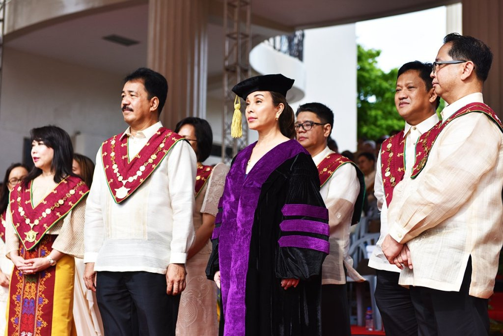Sen. Loren Legarda, the UP Board of Regents, and UP Diliman Chancellor Michael Tan face the candidates for graduation while the citation is read. (Photo by Abraham Arboleda, UP MPRO)