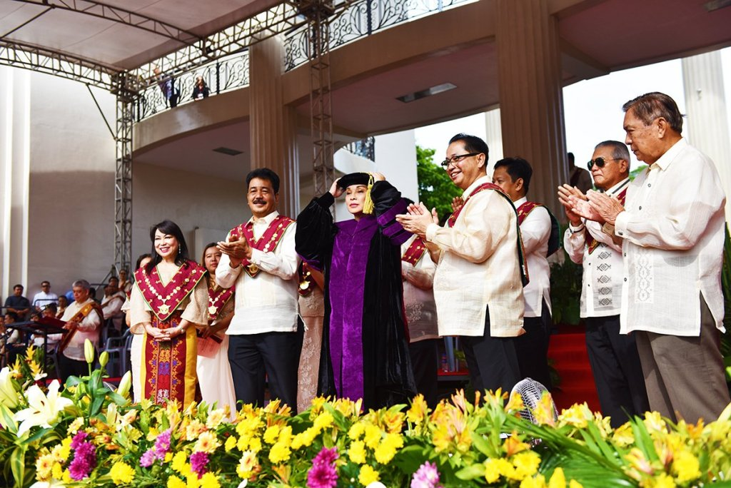 Sen. Loren Legarda is conferred a Doctor of Laws, honoris causa, by the University as led by the Board of Regents. With them are UP Diliman Chancellor Michael Tan, who nominated her, and Legarda's father Antonio Cabrera Legarda. (Photo by Abraham Arboleda, UP MPRO)