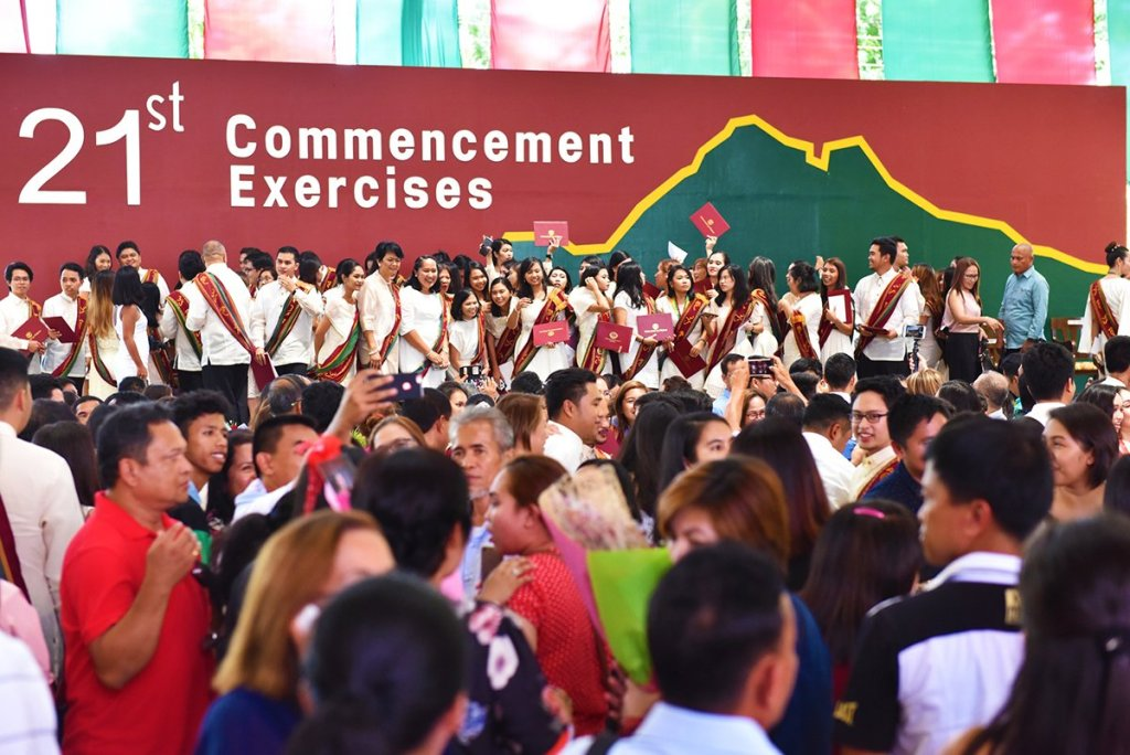 Graduates, families, and faculty at the end of the 21st Commencement Exercises (Photo by Rene Estremera, UP Mindanao)