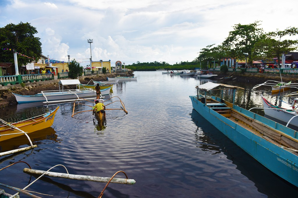 A part of Del Carmen's sea port with a view of its well know contiguous mangrove reserve (Photo by Bong Arboleda, UP MPRO)