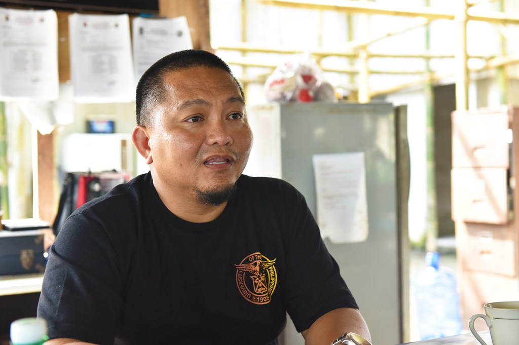 Mayor Alfredo M. Coro II talks about the Seal of Health Governance (SOHG) at Del Carmen's police station after successfully seizing an illegal commercial fishing vessel in Surigao (Photo by Bong Arboleda, UP MPRO)