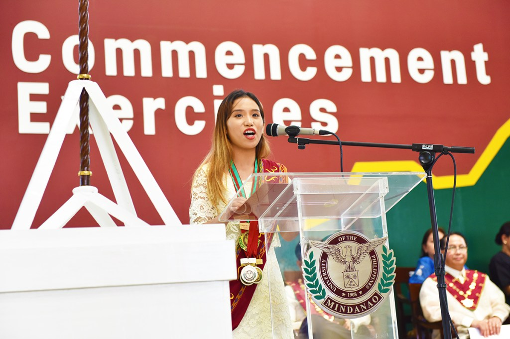 BS Computer Science, magna cum laude, graduate and recipient of the Chancellor's Medal for Academic Excellence Cherrie Mae Andrea E. Sun speaks in behalf of Class 2018. (Photo by Bong Arboleda, UP MPRO)