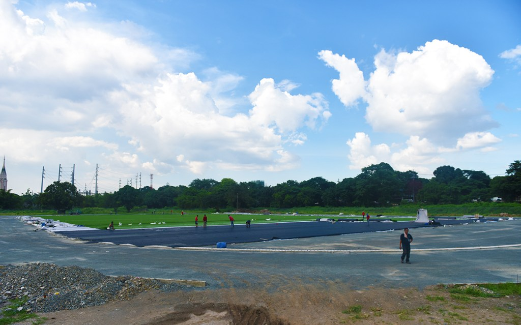Construction of the UP Diliman Sports Complex football field is nearing completion with the application of artificial turf. (Photo by Bong Arboleda, UP MPRO)