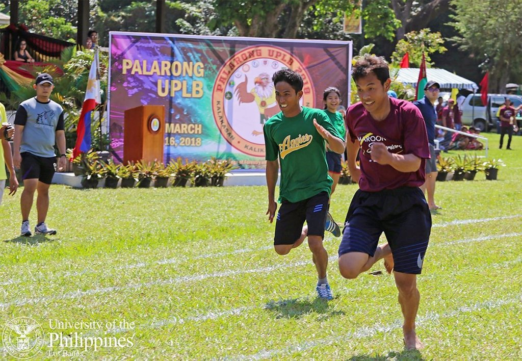 """Constituents of UPLB demonstrate their athletic prowess in events like the 100-meter dash during the annual sports festival called """"Palarong UPLB."""" Palaro aims to promote camaraderie and unity among the faculty, staff, and students through friendly sports competition. The 2018 edition, """"Kalakasan, Kalikasan, Kalusugan,"""" was hosted by the College of Forestry and Natural Resources. (Text by Jessa Jael S. Arana; photo by Christopher V. Labe)"""