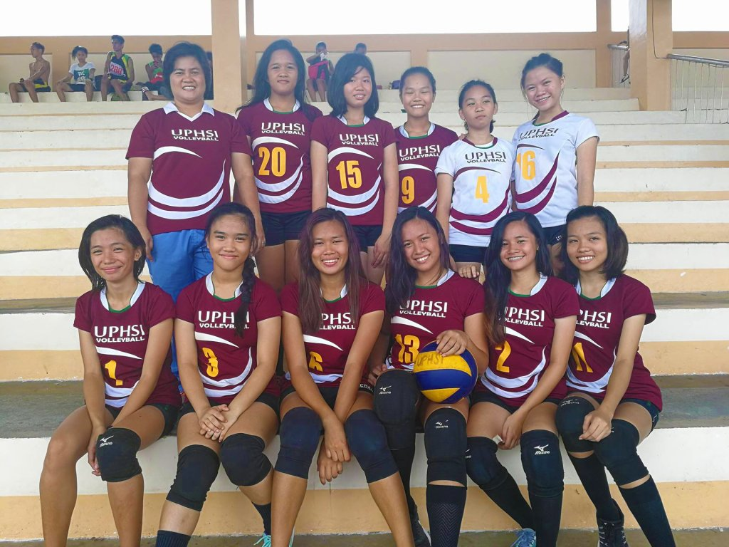 The UP High School Iloilo volleyball team, with their coach Prof. Imelda Catequista. (Photo from Imelda Catequista)
