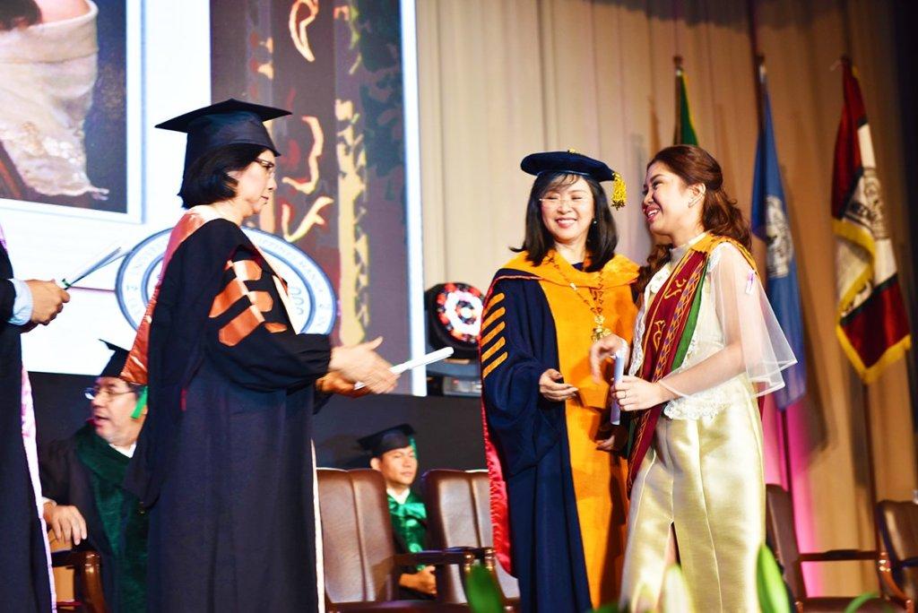 A UP Manila graduate receiving her diploma from Chancellor Carmencita D. Padilla and Vice-Chancellor for Academic Affairs Nymia P. Simbulan. (Photo by Abraham Arboleda, UP MPRO)