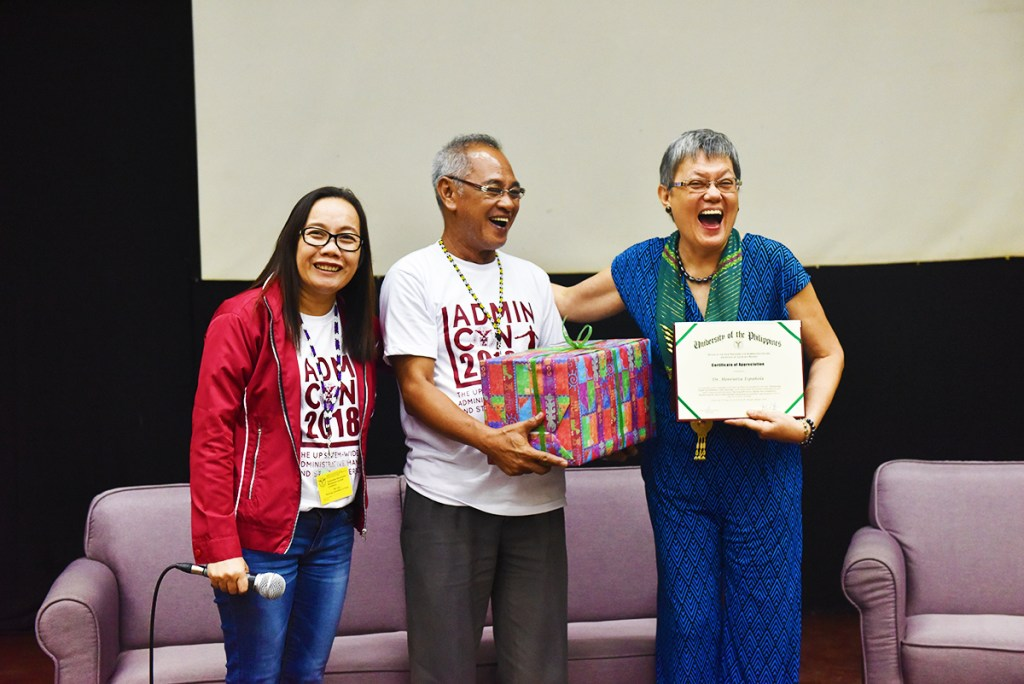 Staff Regent Analiza Fulvadora and Vice President for Administration Nestor Yunque give a token of appreciation to the resource speaker on health and wellness, Henrietta Española, MD of West Visayas State University. (Photo by Bong Arboleda, UP MPRO)