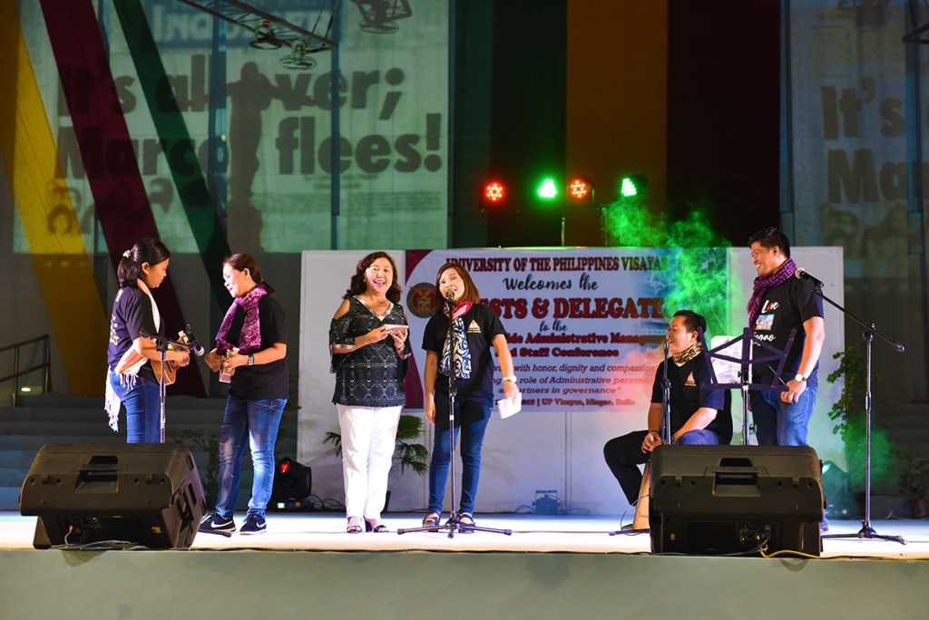UP Cebu delegates, with Chancellor Liza Corro, perform a Cebuano song, with ukuleles, a beatbox, and projected visuals. (Photo by Bong Arboleda, UP MPRO)