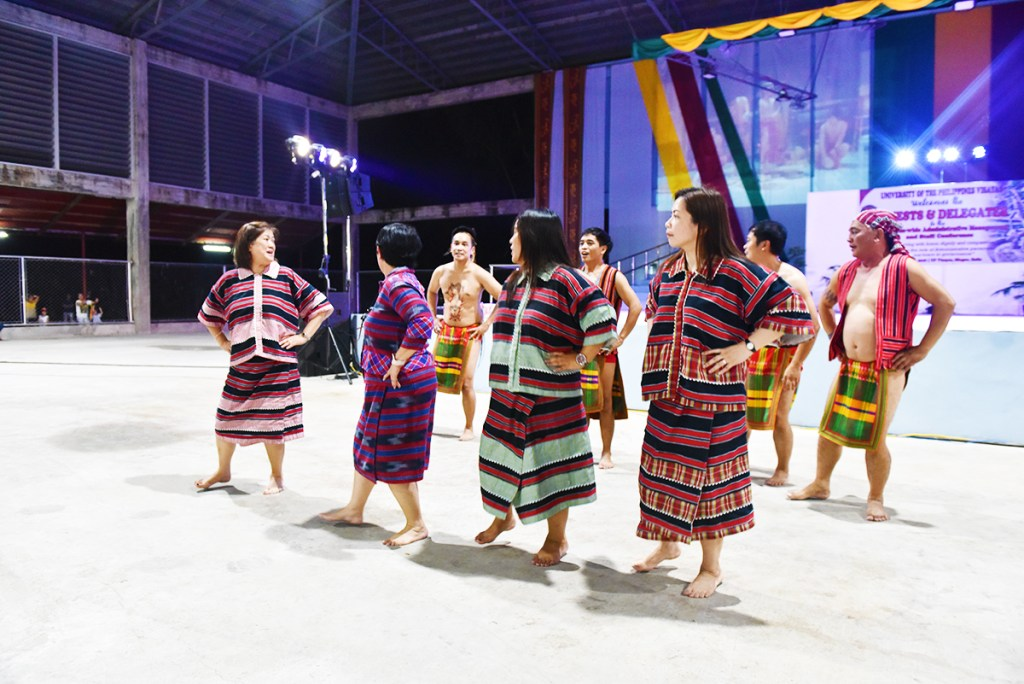UP Baguio delegates simulate a Cordilleran ritual dance before inviting the public to join them in a line dance. (Photo by Bong Arboleda, UP MPRO)