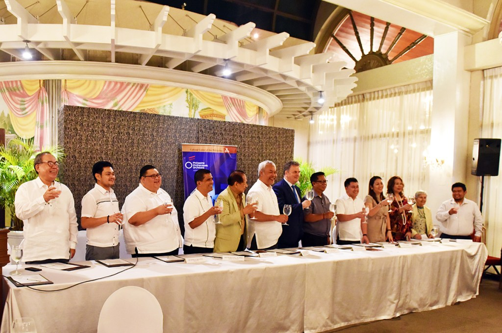 Cultural Center of the Philippines President Arsenio Lizaso, Vice President-Artistic Director Chris Millado (fifth and sixth on the table, from the left), and partners of the Philippine Philharmonic Orchestra for its outreach performances, which include UP as represented by its Vice President for Public Affairs, Jose Dalisay Jr. (extreme left on the table), cheer the partnerships. (Photo by Bong Arboleda)