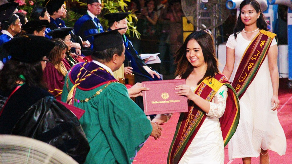 A UPLB graduate receiving her diploma from Chancellor Fernando C. Sanchez, Jr. at the 46th UPLB graduation rites held at the D.L. Umali Freedom Park on June 23, 2018. (Photo by Jun Madrid, UP MPRO)