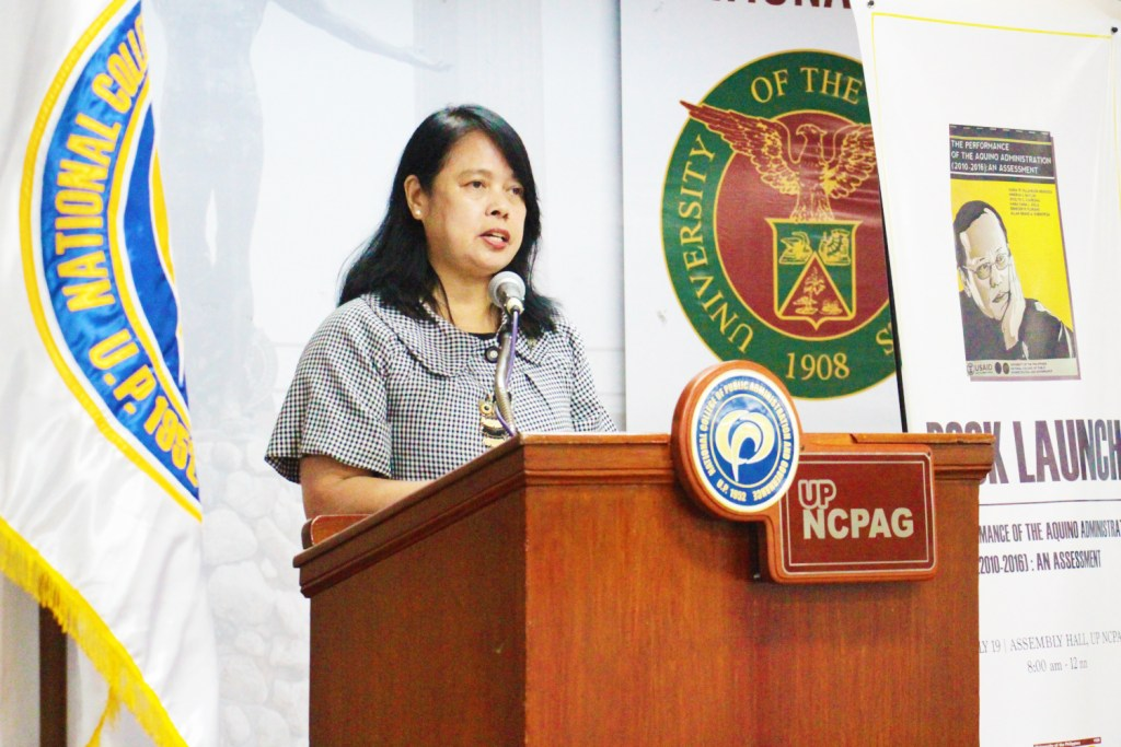 Dean Maria Fe Villamejor-Mendoza of NCPAG welcomes the participants of the forum and book launch held on July 19, 2018 at the NCPAG Assembly Hall, UP Diliman, Quezon City. (Photo by Jun Madrid, UP MPRO).